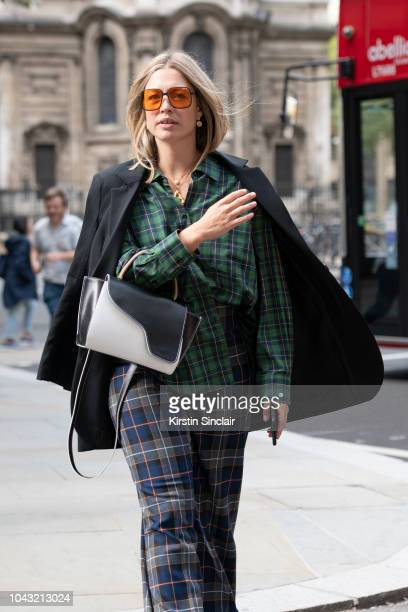 'tArt and Style Director Alexis Foreman wears Zara trousers and shirt HM blazer ATP Atelier bag and Orgreen Optics sunglasses during London Fashion...