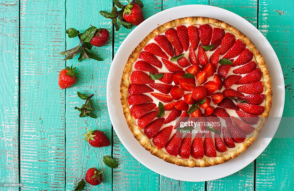 Tart with strawberries and whipped cream decorated with mint leaves. : Stock Photo