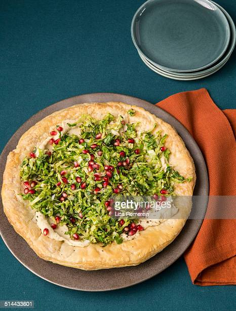 Tart with white bean spread and brussel sprouts