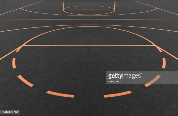 Tartan covered outdoor basketball court with orange playing field lines