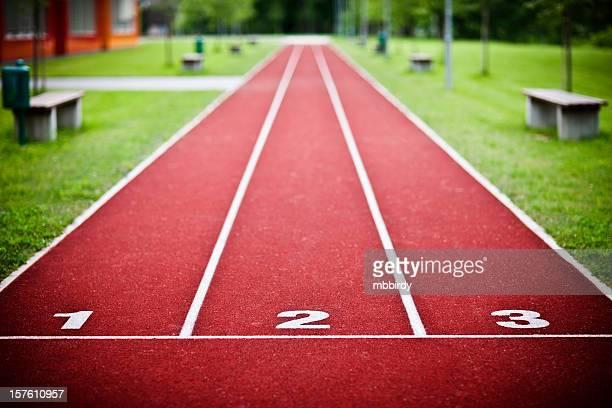 tartan-running sports track - schottenkaro stock-fotos und bilder