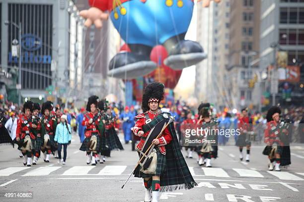 Tartanclad drum major NYPD marching band The 89th annual Macy's Thanksgiving Day parade attracted hundreds of thousands of spectators in spite of...