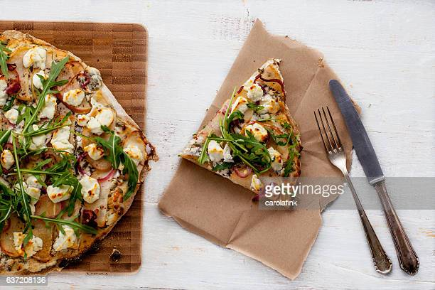 tarte flambée with goat cheese and apple slides - carolafink stock photos and pictures