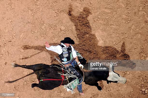 Tarter Porter rides Detour during the Professional Bull Riders World Finals at Mandalay Bay Casino and Hotel October 29 2006 in Las Vegas Nevada