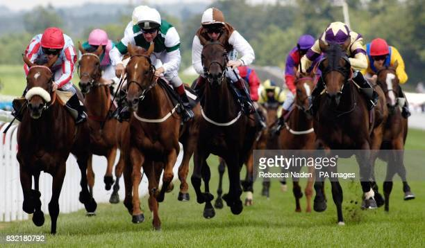 Tartouche ridden by jockey Seb Saunders wins the Lillie Langtry Fillies' Stakes at Goodwood racecourse