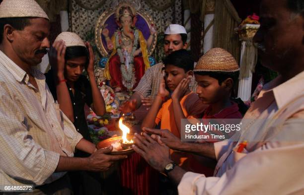 Tarun Mitra Mandal there is communal harmony among the Hindus and Muslims as they take aarti together at the feet of ganesha at Dongri