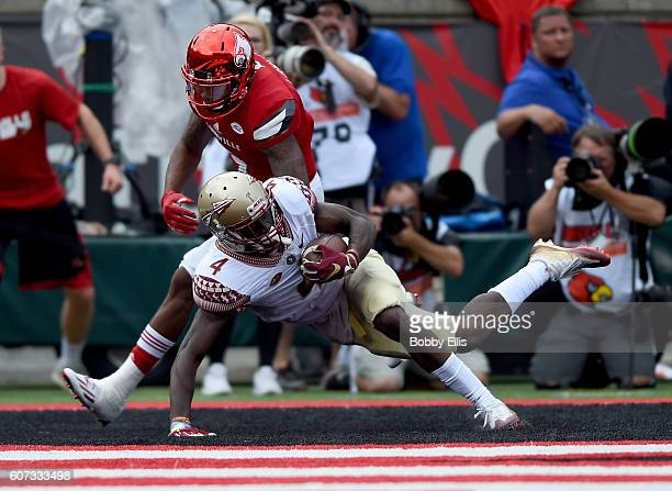 Tarvarus McFadden of the Florida State Seminoles makes an interception in the endzone during the game against the Louisville Cardinals at Papa John's...