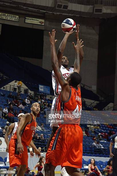 Tarvis Williams of the Fayetteville Patriots shoots over Terence Morris of the Columbus Riverdragons during the game at Crown Coliseum on December...