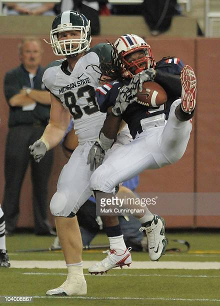 Tarvoris Hill of the Florida Atlantic University Owls intercepts a pass in the endzone in front of Charlie Gantt of the Michigan State Spartans...