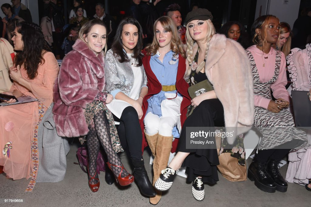 Taryn Manning, Jenna Leigh Green, Emma Myles and Francesca Curran attend the Vivienne Tam front row during New York Fashion Week at Spring Studios on February 13, 2018 in New York City.