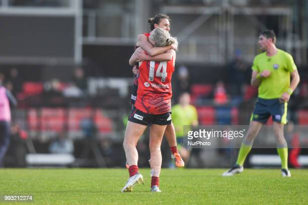 Taryn Orgill of the Casey Demons and Aliesha Newman of the Casey Demons celebrate the win after the VFL Women's round 9 game between the Casey Demons...