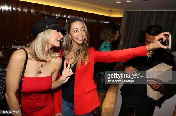 Taryn Walker and Karen Huggins are seen at the Alexandre Birman Bal Harbor Store Opening Event on November 8 2018 in Miami Florida