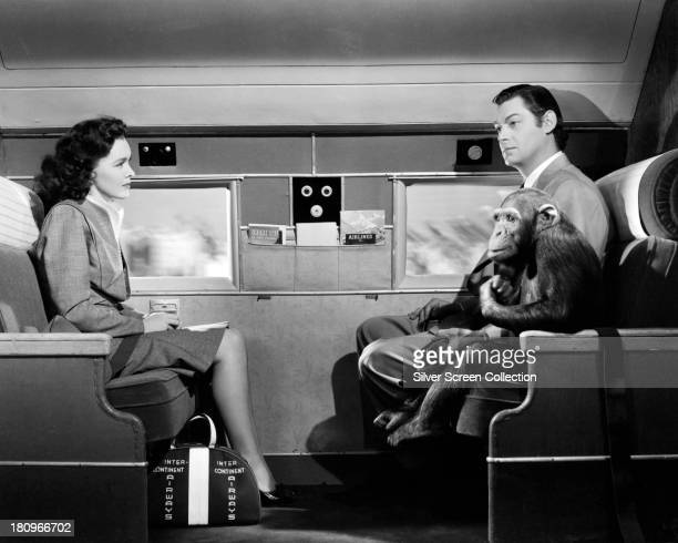 Tarzan played by Johnny Weissmuller Jane Parker played by Maureen O'Sullivan and Cheeta the chimpanzee on board a flight to America in 'Tarzan's New...