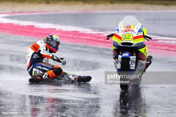 TOPSHOT Tasca Racing team's Belgian ride Xavier Simeon falls from his bike during the San Marino Moto2 Grand Prix race at the Marco Simoncelli...