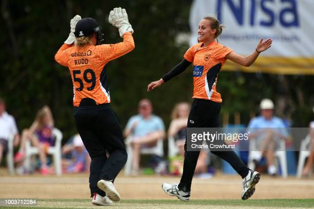 Dane van Niekerk of Surrey Stars hits out while Southern Vipers wicket keeper Carla Rudd looks on during the Kia Super League match between Surrey...