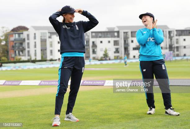 Tash Farrant spekas to Tammy Beaumont as she is awarded her Kent cap prior to the 5th One Day International match between England and New Zealand at...