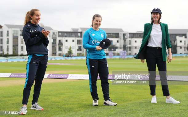 Tash Farrant, Tammy Beaumont and Lydia Greenway smile as they collect their Kent caps prior to the 5th One Day International match between England...