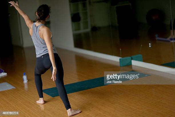 Tash Golden wears yoga pants as she leads a class at the Green Monkey yoga studio on February 12 2015 in Miami Beach Florida On Tuesday Montana state...