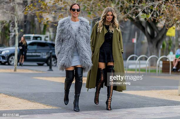Tash Sefton wearing a grey Lilya fur coat a grey Seed Heritage dress black Scanlan overknee leather boots and Elle Ferguson wearing an olive Karen...