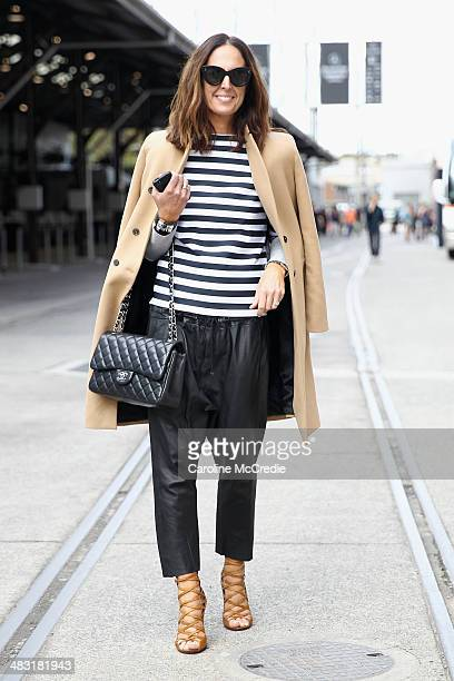 Tash Sefton wearing Bassike shirt and pants Hermes clutch Chanel handbag Zara Jacket and Isabel Marant shoes at MercedesBenz Fashion Week Australia...