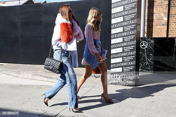 Tash Sefton wearing Off White pants Herringbone shirt Rachel Gilbert collar Chanel handbag and Elle Ferguson wearing Steve May dress Jeffrey Campbell...