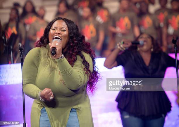 Tasha Cobbs Leonard and Kierra Sheard perform a duet 'Your Spirit' on stage during Tasha Cobbs Leonard Heart Passion Pursuit album release concert at...