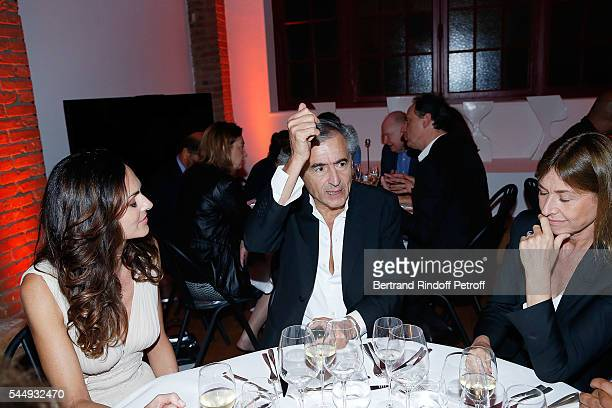 Tasha de Vasconcelos BernardHenri Levy and Nathalie BlochLaine attend Peshmerga Private Screening at Galerie Azzedine Alaia on July 4 2016 in Paris...