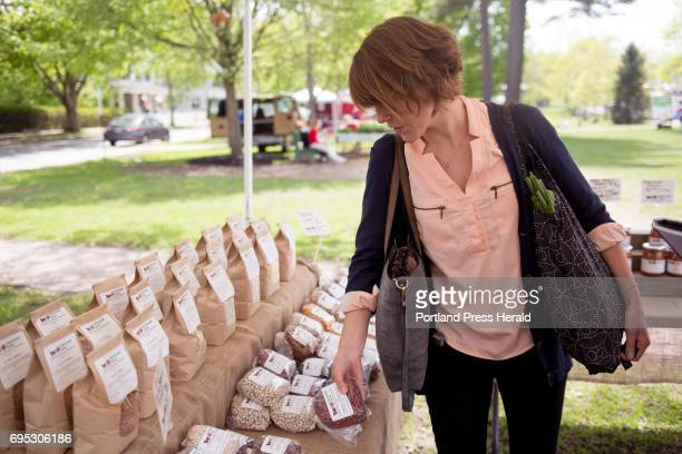 Tasha Gerken buys dried bean from the Fairwinds Farm booth at the Brunswick Farmers' Market Gerken is a nutrition educator in the community health...
