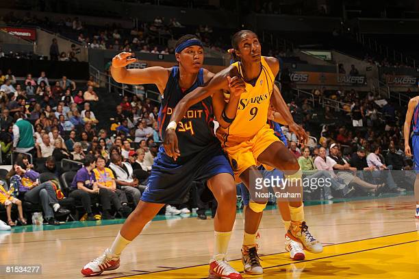 Tasha Humphrey of the Detroit Shock boxes out against Lisa Leslie of the Los Angeles Sparks at Staples Center June 11 2008 in Los Angeles California...
