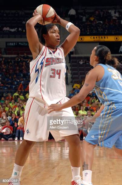 Tasha Humphrey of the Detroit Shock looks to pass the ball against KB Sharp of the Chicago Sky during the WNBA game on July 16 2008 at The Palace of...