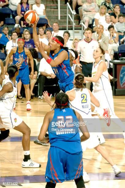 Tasha Humphrey of the Detroit Shock shoots against Kelly Miller of the Phoenix Mercury on June 14 at US Airways Center in Phoenix Arizona NOTE TO...