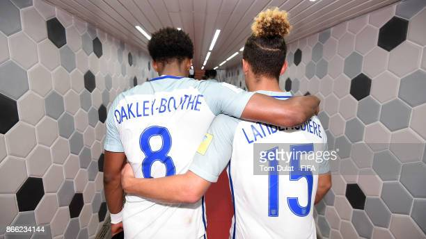 Tashan OakleyBoothe and Joel Latibeaudiere of England walk in the tunnel after the FIFA U17 World Cup India 2017 Semi Final match between Brazil and...