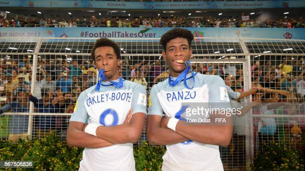Tashan OakleyBoothe and Jonathan Panzo of England pose for photos after the FIFA U17 World Cup India 2017 Final match between England and Spain at...