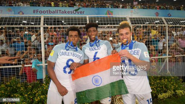 Tashan OakleyBoothe Jonathan Panzo and Joel Latibeaudiere of England pose for photos after the FIFA U17 World Cup India 2017 Final match between...