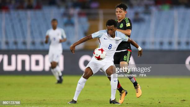 Tashan OakleyBoothe of England battles for the ball with Alexis Gutierrez of Mexico during the FIFA U17 World Cup India 2017 group F match between...