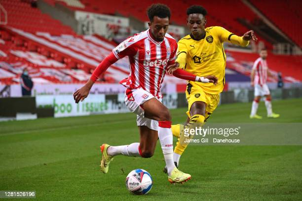 Tashan OakleyBoothe of Stoke City beats Clarke Oduor of Barnsley during the Sky Bet Championship match between Stoke City and Barnsley at Bet365...