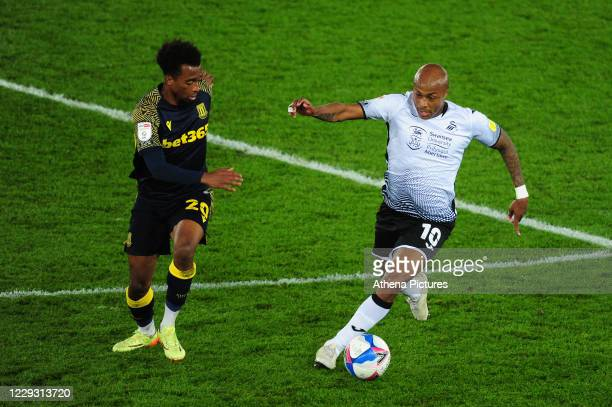 Tashan OakleyBoothe of Stoke City vies for possession with André Ayew of Swansea City during the Sky Bet Championship match between Swansea City and...