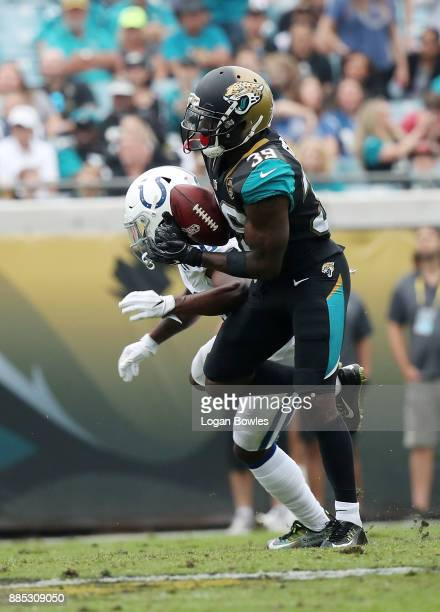 Tashaun Gipson of the Jacksonville Jaguars picks off the football in front of Chester Rogers of the Indianapolis Colts in the second half of their...
