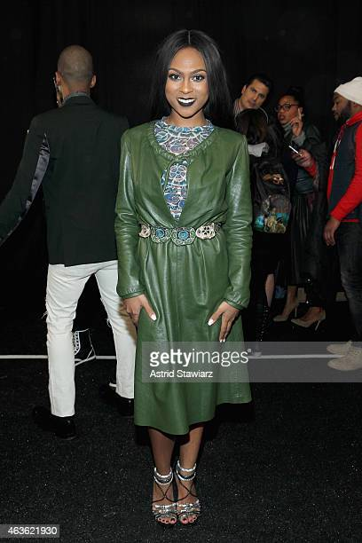Tashiana Washington prepares backstage at the Vivienne Tam fashion show during MercedesBenz Fashion Week Fall 2015 at The Theatre at Lincoln Center...