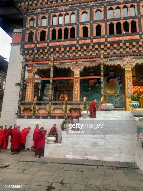 tashichho dzong, buddhist monastery and fortress, monks entering the building - bhutan royalty stock pictures, royalty-free photos & images