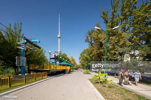 tashkent tv tower with tashkentland theme park in the foreground, tashkent, uzbekistan, 2019 - dictator stock pictures, royalty-free photos & images