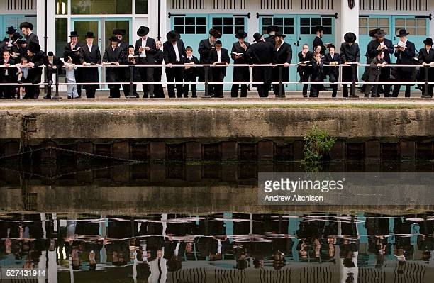 Tashlikh is a Jewish practice that is performed during Rosh Hashanah Men and women gather near a large body of flowing water and symbolically 'cast...