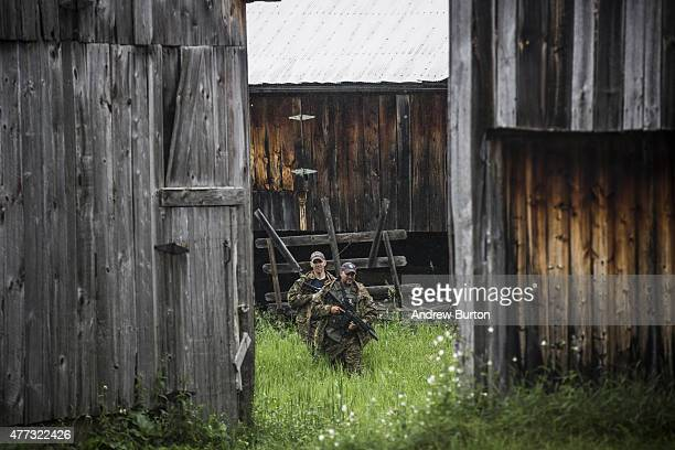 Task force of U.S. Marshalls and police officers go door to door searching for two escaped convicts on June 16, 2015 outside Dannemora, New York. The...