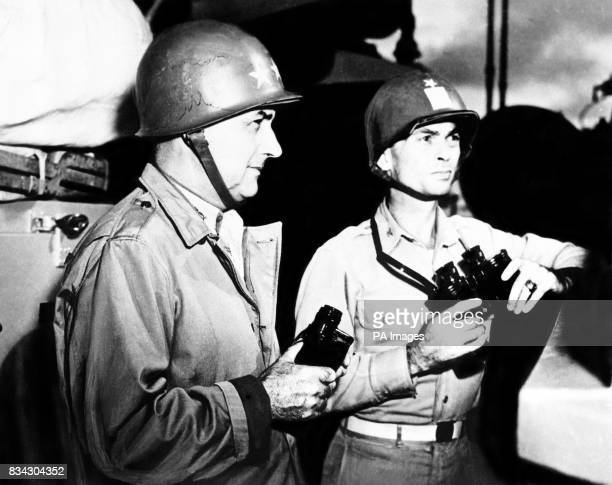 Task force on the alert Vice Admiral Arthur D Struble and his chief of staff Captain George T Mundroft on the bridge of the heavy cruiser flagship of...