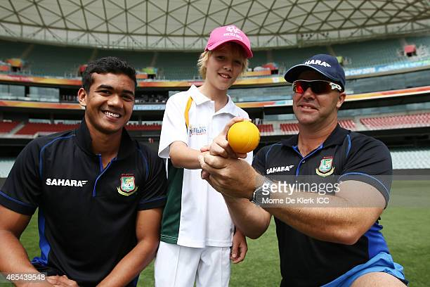 Taskin Ahmed and bowling coach Heath Streak of the Bangladesh Cricket team give young cricketer Fynn Martin some bowling advice during the ICC...