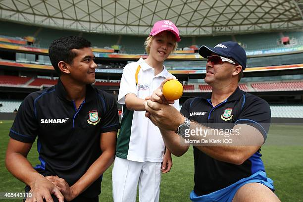 Taskin Ahmed and bowling coach Heath Streak of the Bangladesh Cricket team give young cricketer Fynn Martin some bowling advise during the ICC...