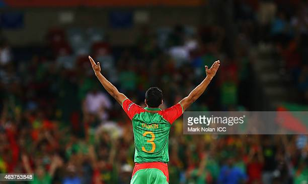 Taskin Ahmed of Bangladesh celebrates after taking the wicket of Hamid Hassan of Afghanistan during the 2015 ICC Cricket World Cup match between...
