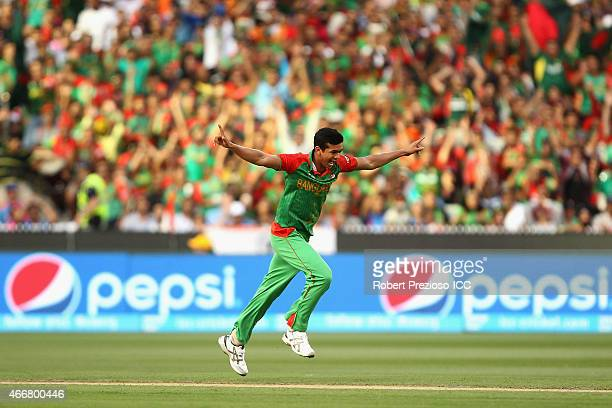 Taskin Ahmed of Bangladesh celebrates after taking the wicket of Rohit Sharma of India during the 2015 ICC Cricket World Cup match between India and...