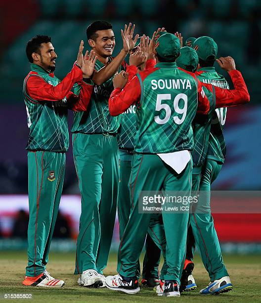 Taskin Ahmed of Bangladesh is congratulated on the wicket of Zeeshan Maqsood of Oman after he was caught by Mahmudullah of Bangladesh during the ICC...
