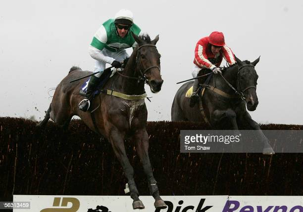Taskina ridden by P Davy and Eggmount ridden by W McCarthy jump the final fence during the Andrew Hopkins Concrete Conditional Jockeys Handicap...